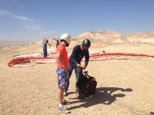 preparation for gliding over Dead Sea