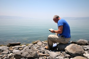 Reading Bible on Sea of Galilee